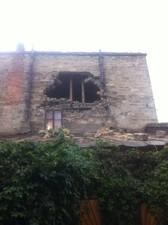 В Одессе из-за ливня снова рухнула часть стены жилого дома